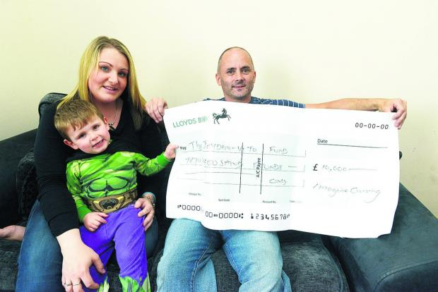 This Is Wiltshire: Jayden-Vito Mazzotta -Drapper with his parents Charlene Mazzotta and Jason Drapper, has been given £10,000 by Image Crusing