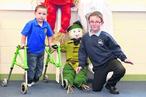 This Is Wiltshire: Ollie Baker and brother Joshua. The scarecrow trail will raise money for their school and pre-school