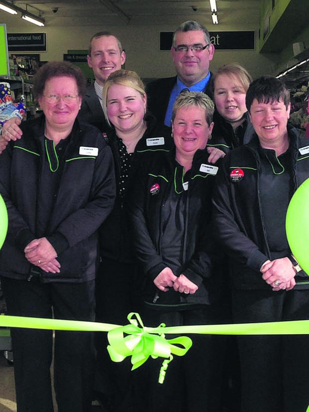 This Is Wiltshire: The store team at The Co-operative on Blackmore Road, Melksham, celebrate the opening of the new-look store following its recent refit