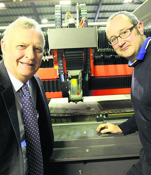This Is Wiltshire: MD Richard Burman and operations manager Kevin Aiston with the new laser cutter. Inset, the laser (VS321) By Vicky Scipio