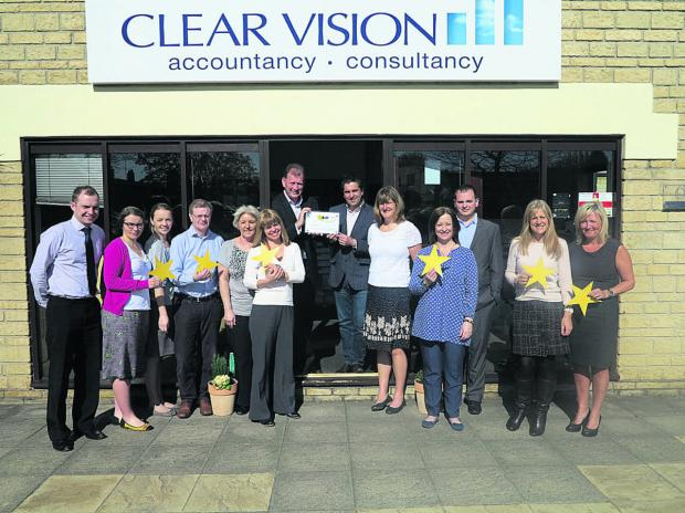 This Is Wiltshire: Accountancy firm Clear Vision has attained the highest rating for customer service. Managing director Rob Walsh is in the centre on the left, with director Matthew Rogers on the right