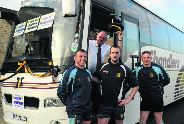 This Is Wiltshire: Chandlers coach driver Harry Clark with players Barry Coombs, left, captain Matt Howard and Kyle Knight