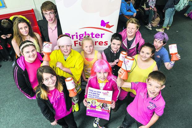 This Is Wiltshire: A riot of colour for pink and yellow day at Royal Wootton Bassett Academy to help raise money for the new Breast Cancer treatment at the Great Western Hospital