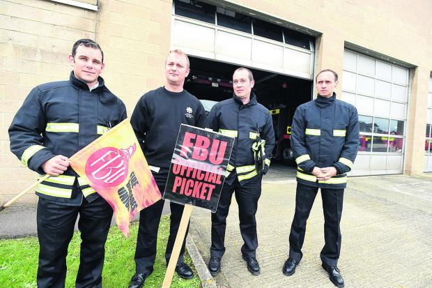This Is Wiltshire: Manning the picket line outside Chippenham Fire Station today were, from left, Watch Manager Paul Hanlon and firefighters Rob Kymoch, Colin Tailby and Paul Peche