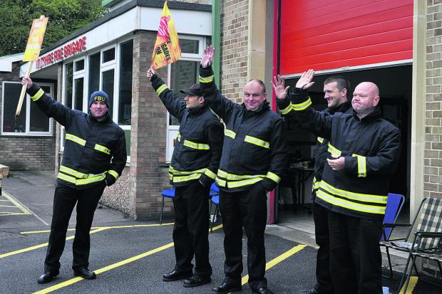 This Is Wiltshire: Trowbridge firefighters manning the picket line today waved to drivers tooting their car horns in support