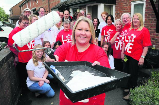 This Is Wiltshire: Front, Corrina Rose, from Bromford, who organised the                            painting and decorating charity  event at a supported housing scheme in Old Walcot with volunteers  Nationwide, Bromford and Love Swindon
