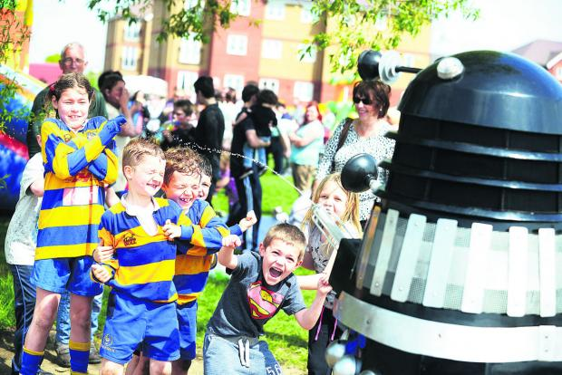 This Is Wiltshire: A Dalek squirts water at passing children at the fun day for the National Autistic Society. Pictures: THOMAS KELSEY