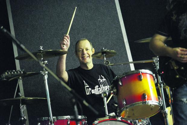 This Is Wiltshire: Gerry Hunt behind the drums at his fundraising gig. Picture: THOMAS KELSEY