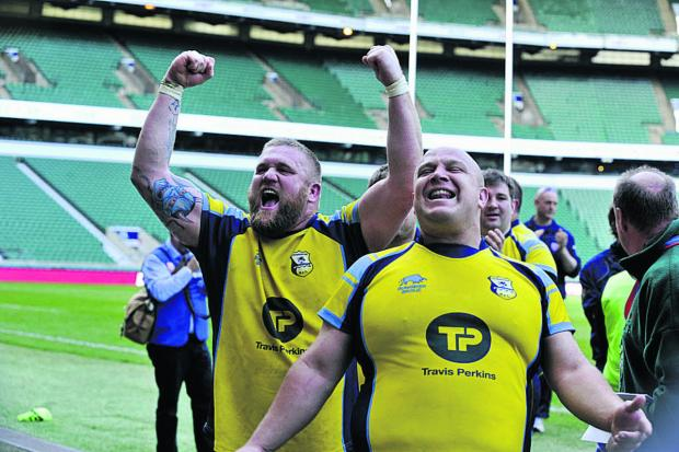 This Is Wiltshire: Sean Jones, left, and Sam Edwards celebrate at Twickenham