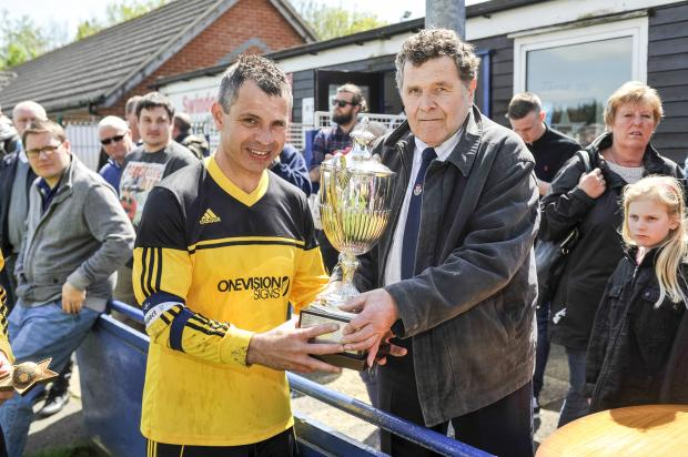 This Is Wiltshire: Lower Stratton skipper Sean Hooton accepts the George Thomas Cup