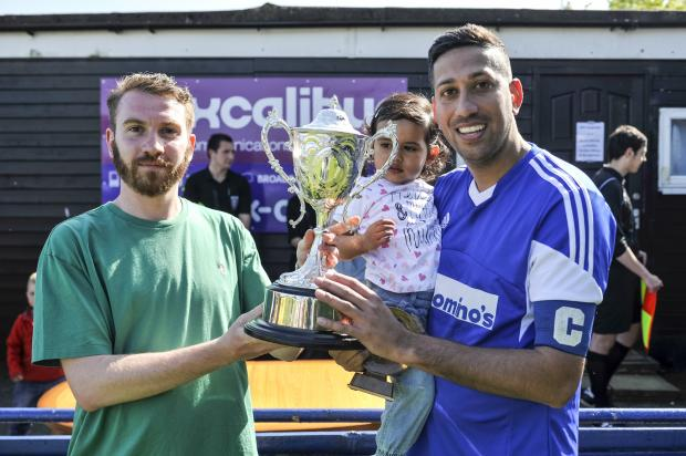This Is Wiltshire: Adver sport writer Tom Bassam presents the trophy to Ajay Sahota