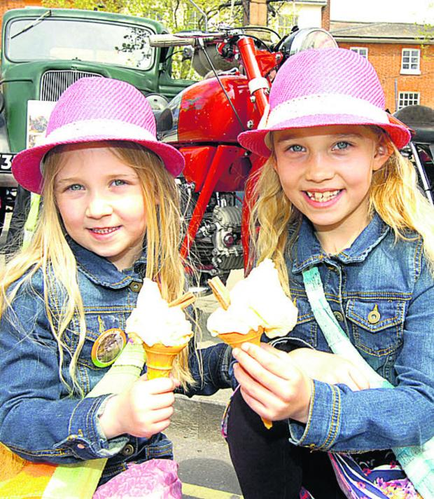 This Is Wiltshire: Cool time for Amelia and Ella with ices in the sun at Devizes Lions' May Day Fair