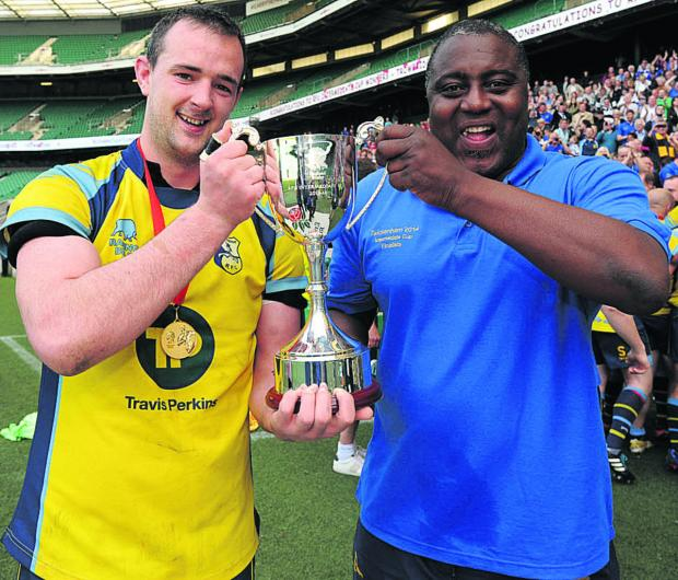 This Is Wiltshire: Trowbridge club captain Matt Howard and coach Steve Ojomoh with the RFU Intermediate Cup at Twickenham on Sunday