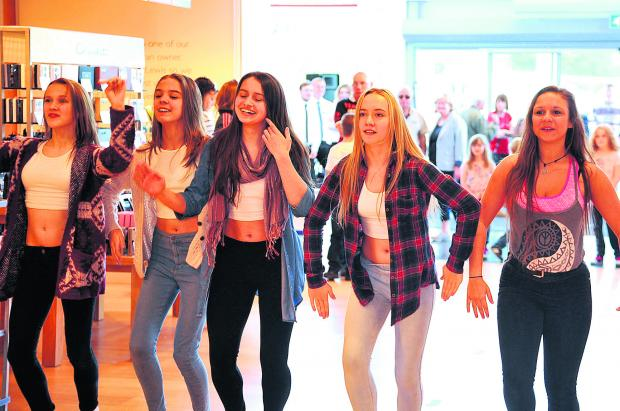 This Is Wiltshire: Tanwood School for Performing Arts tap dancers doing a flash mob at John Lewis, Mannington