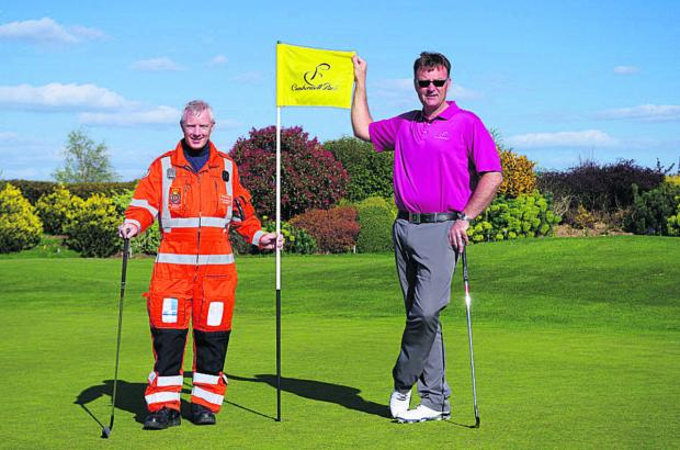 This Is Wiltshire: Steve Riddle, Wiltshire Air Ambulance paramedic, and John Jacobs, head professional at Cumberwell Park Golf Club, prepare for the charity golf day on September 19