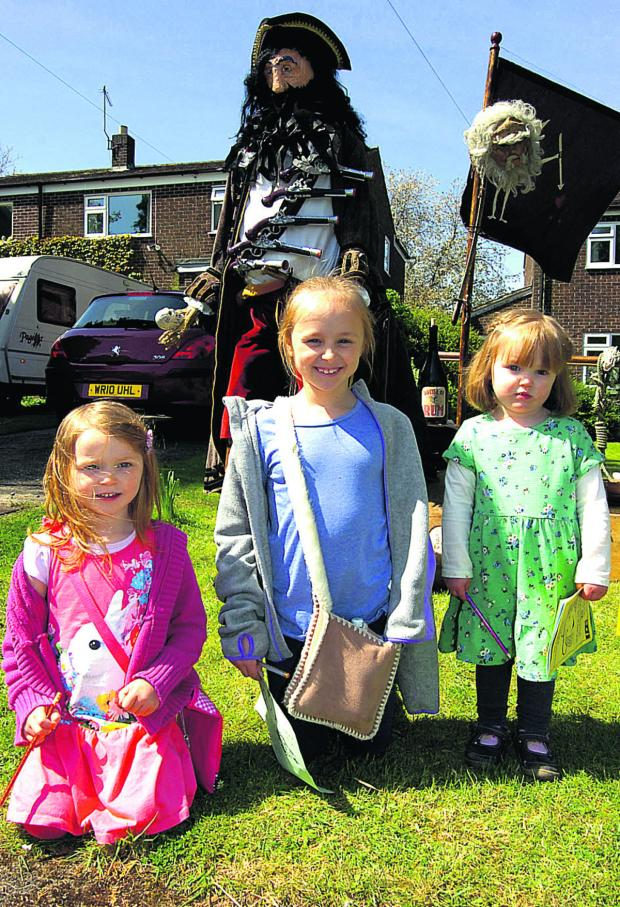 This Is Wiltshire: Tali, Issy and Bethan enjoy Urchfont Scarecrow Festival. (PM1227) Picture by Paul Morris