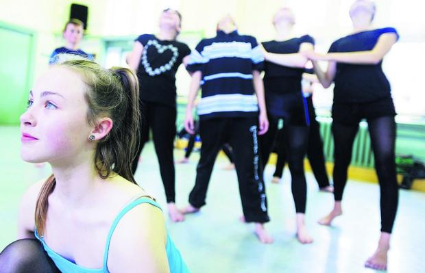This Is Wiltshire: Children aged nine to 12 from Swindon Dance rehearsing the routine they will be performing at the Royal Ballet School  Picture: THOMAS KELSEY