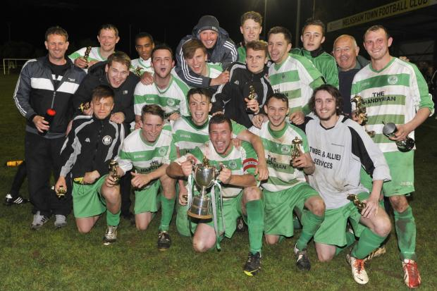 This Is Wiltshire: Westbury United Reserves celebrate with the Knockout Cup last night (Photo: Glenn Phillips)