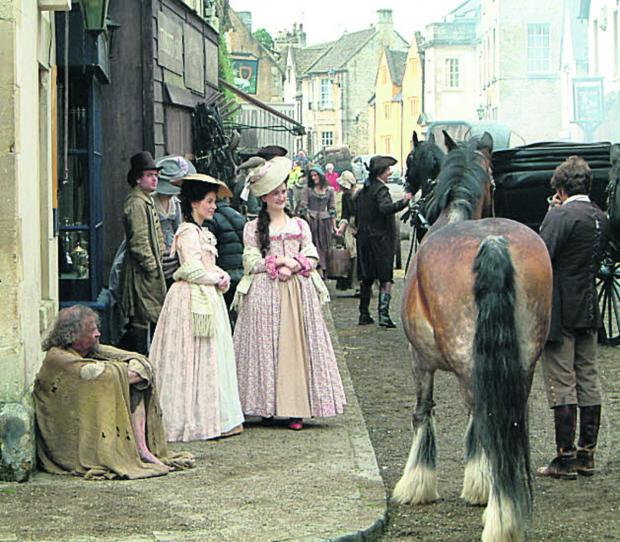 This Is Wiltshire: Corsham's historic streets are so outstanding they are frequently used as film locations, seen here as a