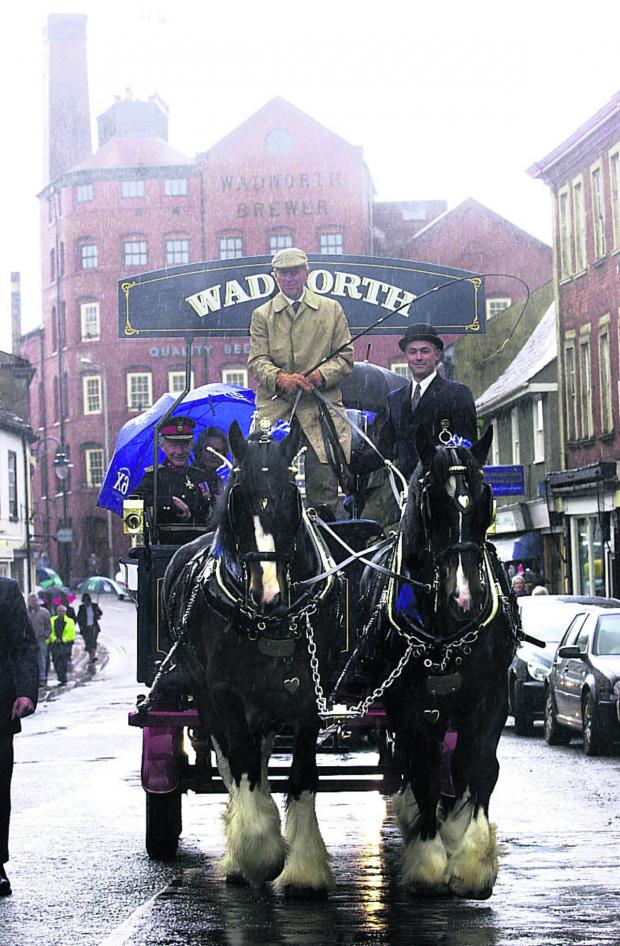 This Is Wiltshire: The Duke of Edinburgh drove one of the Wadworth drays on a visit to Devizes in 2004