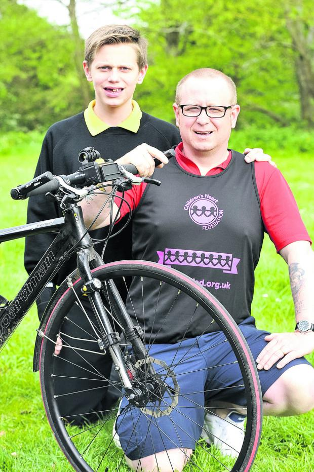 This Is Wiltshire: Richard Stocker, who completed a 340-mile bike ride across Europe for the Children's Heart Federation and raised £1,500 pictured with his son Lewis, who had three heart operations before the age of 14