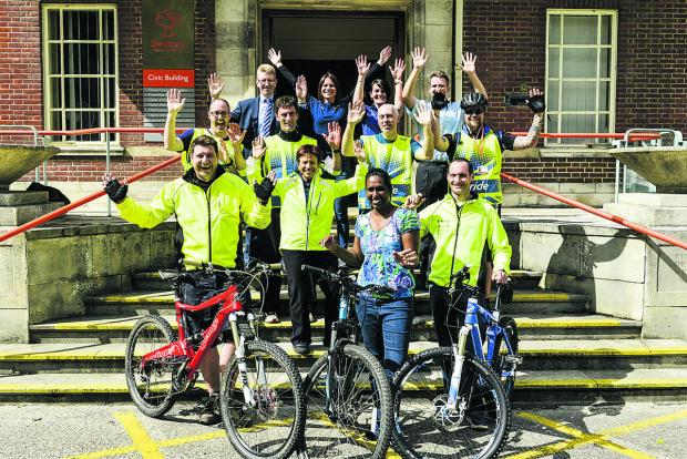 This Is Wiltshire: Ready to pedal are Simon Oxlade, Vany Mohanraj, Mark Williams, Deb Tremblin, Craig Scott, Steve Goulding, Rob Norman, Will Melrose, Ian Bickerton, head of Swindon Council's leisure, libraries and culture, Joanne Downing, British Cycling recreation manag