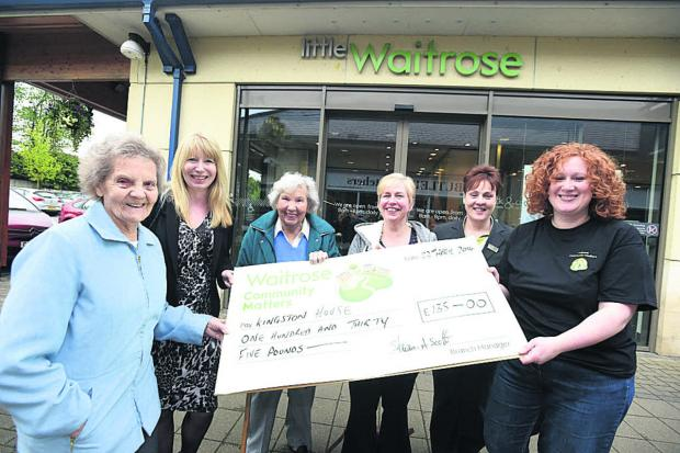 This Is Wiltshire: From left, Sylvia Matthews, Linda Summers, Barbara Hills (from Kingston House), Kingston House manager Carol Grainger, Waitrose team leader Katy Bartlett and Waitrose Community Matters champion Melissa Hunt