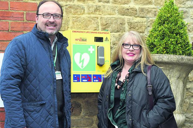 This Is Wiltshire: Coun Peter Hutton with Alison Butler next to the defibrillator at The Jolly Huntsman in Kington St Michael                                                                                                         (DV1265) By Diane Vose