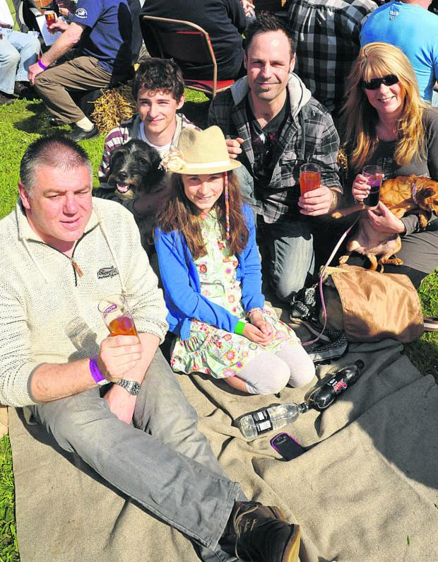 This Is Wiltshire: Top left, Bob Laurie, Ronnie Laurie, Norah Hawkins, Jamie R Hawkins and Millie Hawkins in the crowd