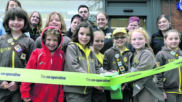 This Is Wiltshire: Members of the 1st Aldbourne Brownies open the new look Co-operative food store