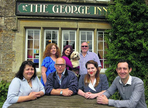 This Is Wiltshire: From front left are Raff Weaver, Colin Weaver, Erin Weaver and Jonathon Russell, the new team at the pub. Harriet Jenkinson, Cara Jenkinson, Mark Jenkinson and dog Jasmin, at the back, have handed over the reins                                 (PM1213) By