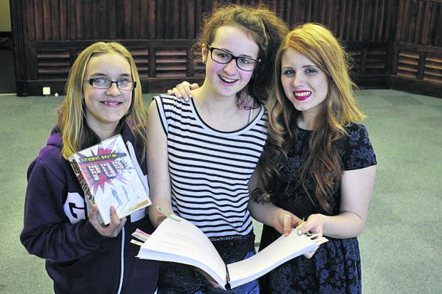 This Is Wiltshire: Issy Jacob, centre, is staging a production of Pop! but needs more young actors. With her at a rehearsal at Trowbridge Town Hall are Beth Bailey, left, and Laura-Jayne Burt