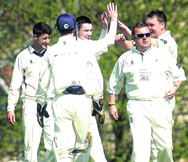 This Is Wiltshire: Box celebrate after Dave Crawford captured the wicket of Urchfont's Joe Dorgan during their Division One clash on Saturday