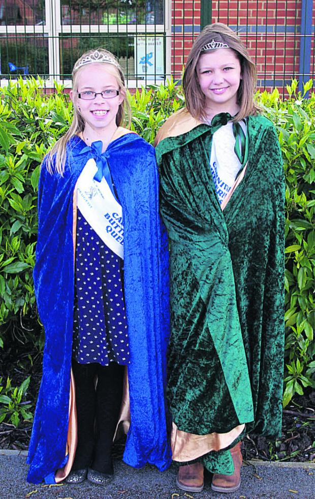 This Is Wiltshire: Trowbridge Carnival Butterfly Queen Imogen Bailey, right, 10, and her attendant Ruby Butler, nine.  Photo: Kevin Hartley