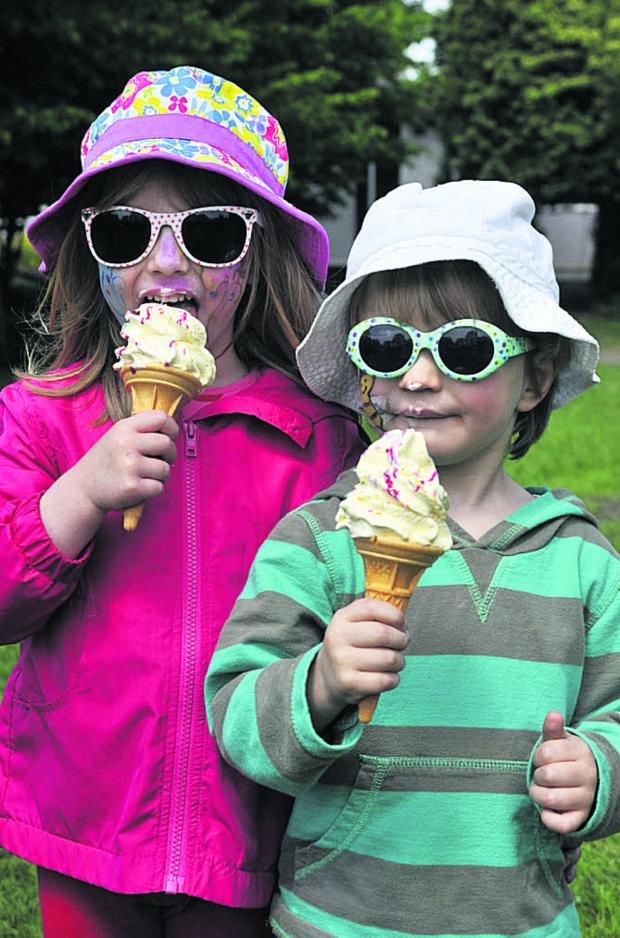 This Is Wiltshire: Olympia and Machlon Woolley enjoy an ice cream in the sunshine