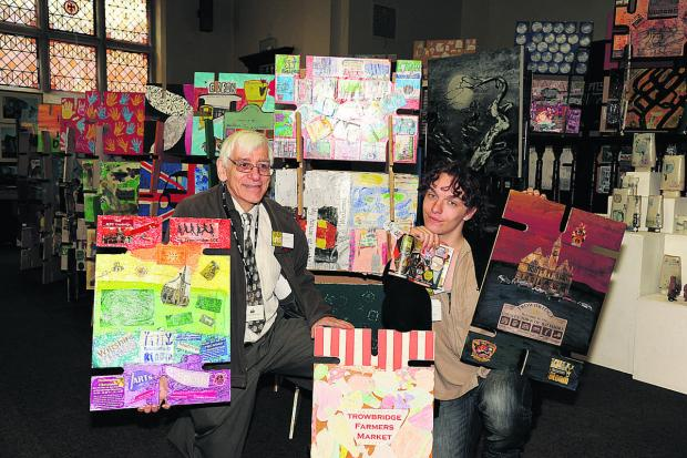 This Is Wiltshire: Robert Colebourne and Kieran Mceleny with the house of cards designed and made by local pupils for the Collaborative Schools Ltd ARTrowbridge – a display for the Cloth Road Arts week