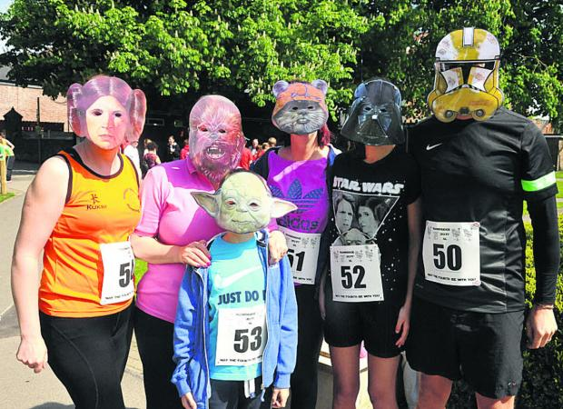 This Is Wiltshire: Behind the masks are Joanne Gillespie, Sophie Murray with Jake, Lauren, Leanne and Richard Roberts