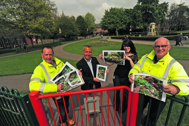 This Is Wiltshire: Staff member Nick Allford ,Sharl Adabashi with Town Council staff – Becci Mees and Bill Austin – with the plans for rock and herb gardens in Trowbridge Park.                 Photo: Trevor Austin (48723)