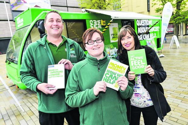 This Is Wiltshire: From left, mobile facilities officer Phil Warner and cancer information support specialists Michelle Smith  and Niki McCloud with the Macmillan Support