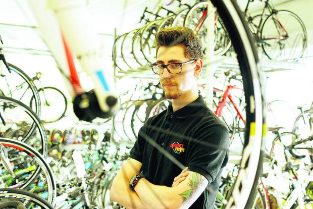 This Is Wiltshire: Tom Holden, of Hargroves Cycles, is upset that a special Sworks Enduro FSR Carbon 2011 bike worth £5,900 was stolen from the shop