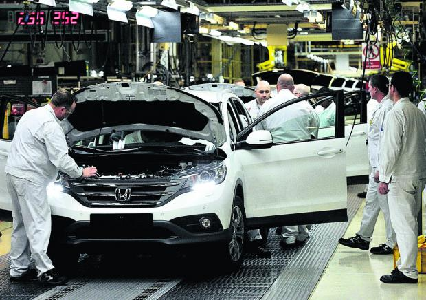This Is Wiltshire: Workers on the production line at the Honda Plant in Swindon