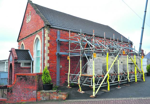 This Is Wiltshire: Rehoboth Strict Baptist Chapel at the former college site is undergoing building work after the walls started cracking