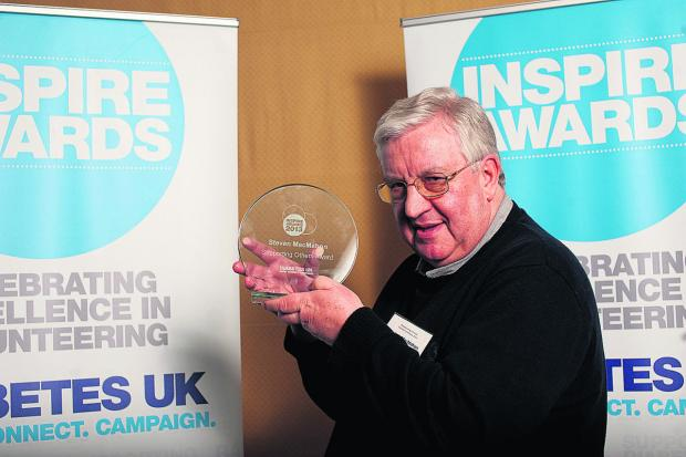 This Is Wiltshire: Volunteer Stephen MacMahon with the Inspire Award he received from Diabetes UK in March