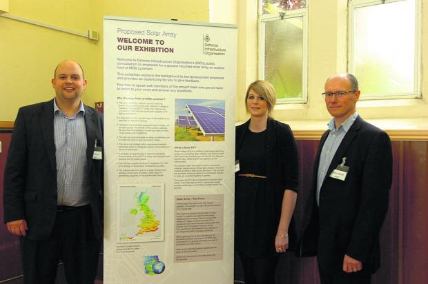 This Is Wiltshire: Presenting details of the plans for 160,000 solar panels at MoD Lyneham are, left to right, Neil Martyn, principal consultant, Sarah Phipps, assistant consultant and Angus Martin, technical director from AMEC