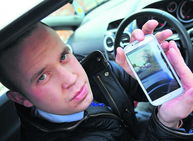 This Is Wiltshire: Lee Clayton with footage he took on his mobile phone after the near miss