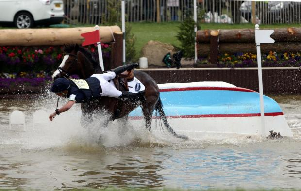 This Is Wiltshire: Mildenhall-based New Zealander Tim Price, riding Wesko falls into the water