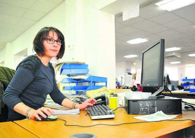 This Is Wiltshire: Adver reporter Marion Sauvebois at work in the newsroom