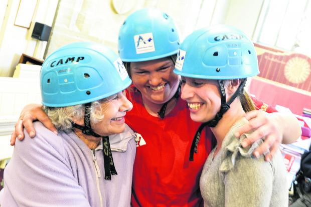 This Is Wiltshire: Smiles all round after Helen Hopkins, her daughter Christina Foote and granddaughter Phillippa Collins completed their abseil