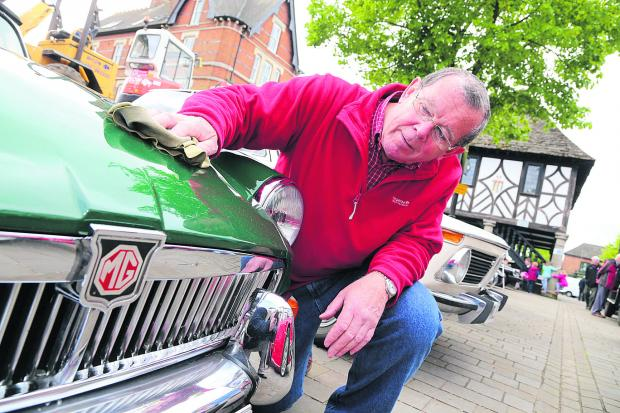 This Is Wiltshire: Raymond Pile pictured with his 1970 MG/B which was on display on Saturday