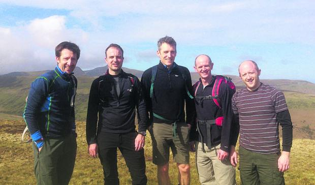 This Is Wiltshire: Dan Jones, James Vaughton, John Fuggle, Dave Joyce and Tom Vaughton train on the Brecon Beacons ahead of their challenge next month